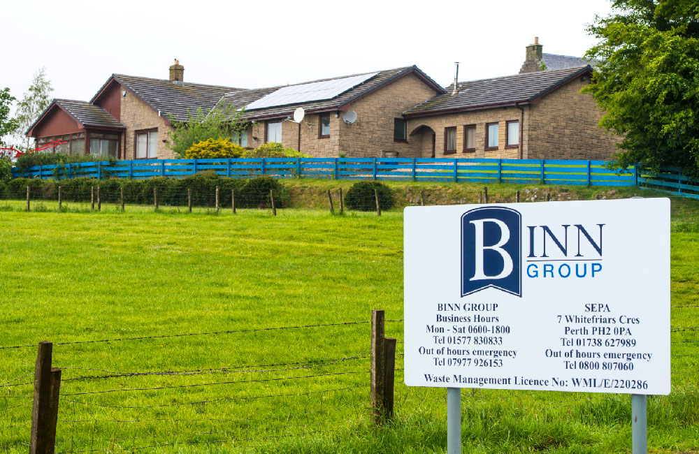 Binn Group Binn Farm showing house and notice board with contact details