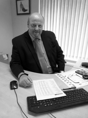 Binn Group Chief Executive Allan MacGregor sitting at a desk