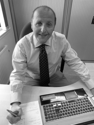 Binn Group Commercial Director Jim Brown sitting at a desk