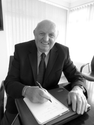 Binn Group Chairman John MacGregor sitting at a desk