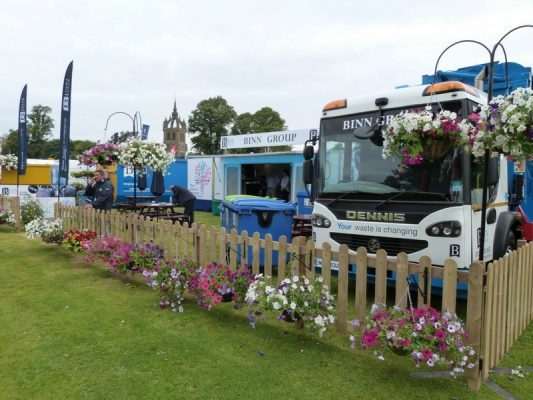 Binn Group stand at Perth Show showing branded trucks