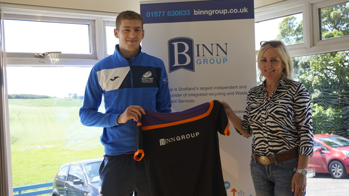 Binn Group brand and marketing manager Louise MacGregor wishes squash player Rory Stewart well for the coming season wearing the Binn Group branding on his shirt.