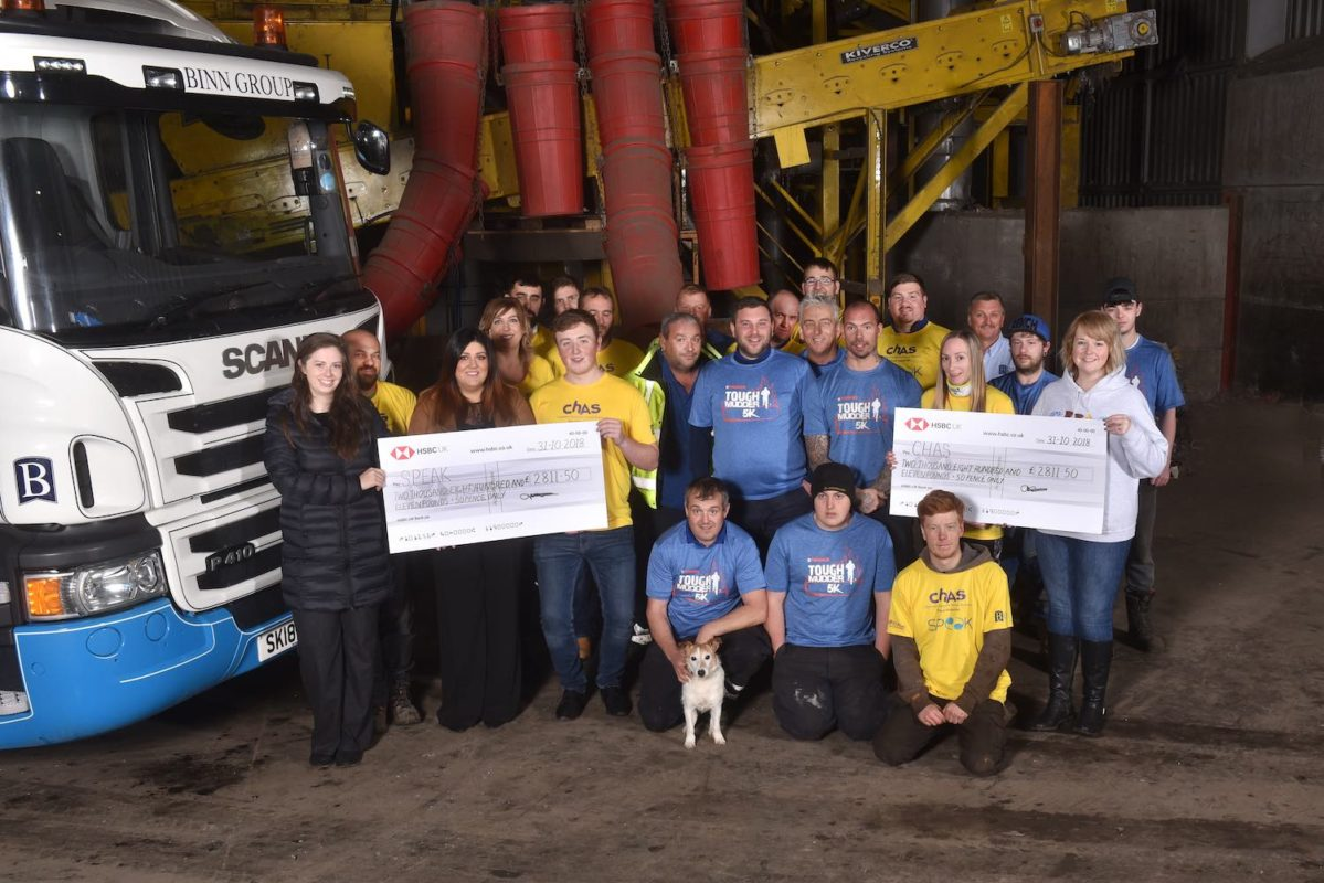 Binn Group hand over cheques to CHAS and SPEAK