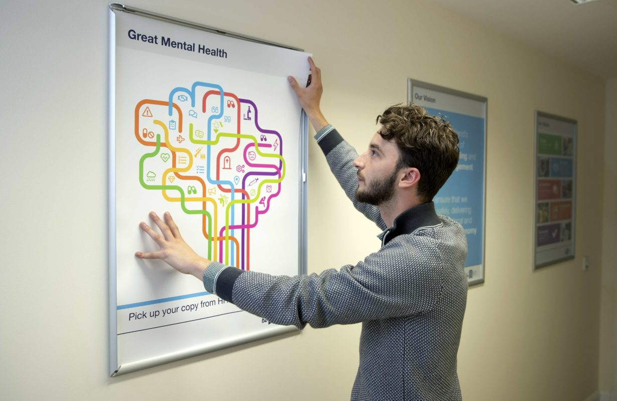 Danny McAtear, Binn Group HR Manager with the new mental health posters
